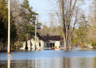 House in rural area surrounded by flood water